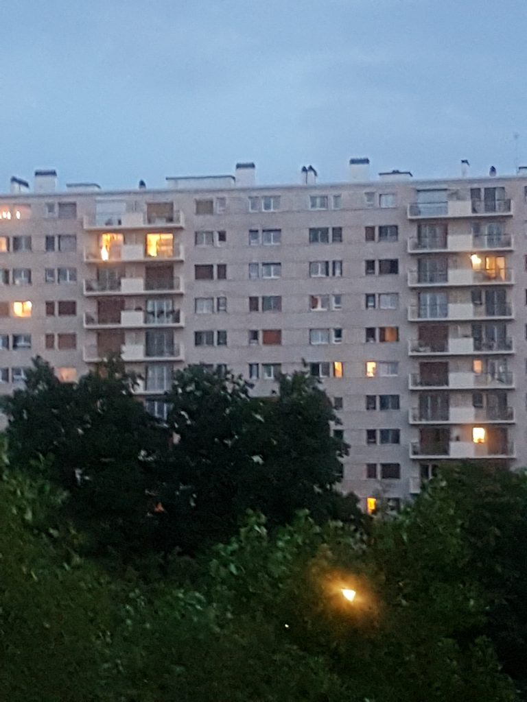 The apartment blocks behind the bench